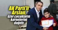 AK Parti'li Arslan, özel çocukların karnelerini dağıttı